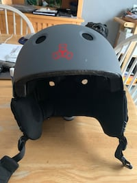 Black and gray Triple eight snowboarding helmet worn only once or twice  Pelham, 03076