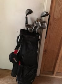 black and red golf bag with golf clubs Potomac