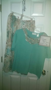 green and beige boat-neck shirt and floral skirt Columbus