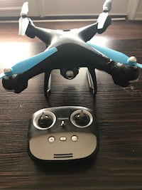 black and gray quadcopter with controller East Lansing, 48823