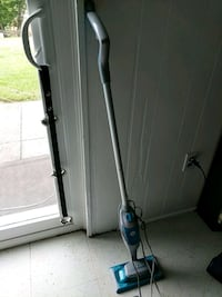 black and gray steam mop