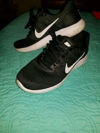 pair of black-and-white Nike running shoes St Louis, 63150