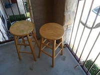 two brown wooden bar stools Converse, 78109