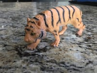 brown and black tiger plush toy Raleigh