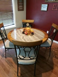 round brown wooden table with four chairs dining s Lincoln, 19960