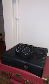 Xbox 360 with gaming accessory. No other cords