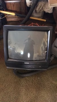 black CRT TV with remote 2225 mi