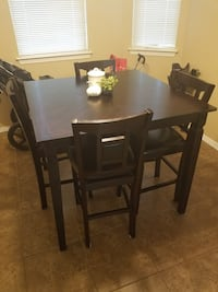 Rectangular brown wooden table with four chairs dining set El Paso, 79938