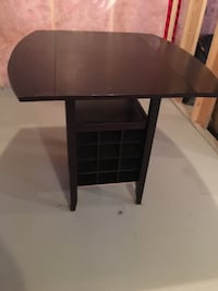 Wood table with built in wine rack in the bottom Edmonton, T6W 2W6