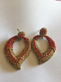red beaded gold-colored drop earrings