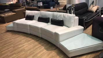 Unique Curve Sectional with Real Leather Finish!