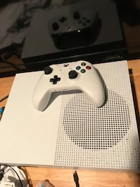 white Xbox One console with controller WASHINGTON