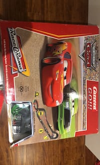 McQueen race track set comes with 4 vehicles- Go Carrera