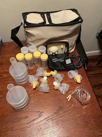 Medela breast pump comes with everything in the pictures