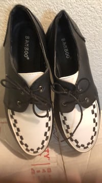 pair of black-and-white Sperry boat shoes Clearlake, 95422