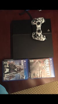 Sony PS4 console with controller and game cases Westlake, 44145
