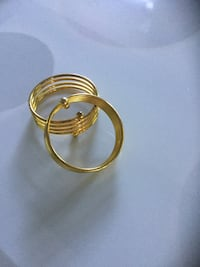 Gold-colored and silver-colored bangle Surrey, V3S 6M5