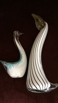 """Pair of glass shore animals pelican and swan. Pelican is 11"""" and swan is 8"""". Carolina Shores, 28467"""