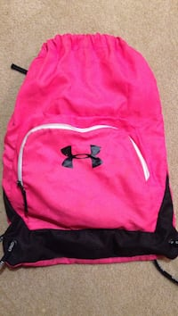pink and black Under Armour drawstring bag