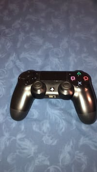 Black sony ps4 game controller Calgary, T2V