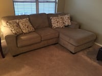 Tan fabric 2-seat sofa with throw pillows