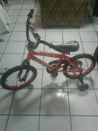 toddler's red and black bicycle with training wheels Chicago, 60651