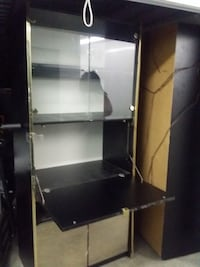 Black and gray metal framed glass display cabinet