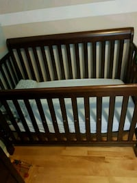 baby's brown wooden crib Montréal, H1H 5E2