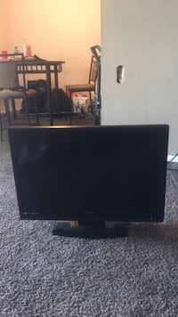 black flat screen TV with outremote Capitol Heights, 20743