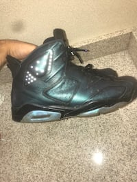 pair of black Air Jordan 6's 67 km