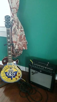 Epiphone les paul electric guitar with new amp Calgary