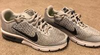 pair of gray-and-black Nike running shoes Friendswood, 77546