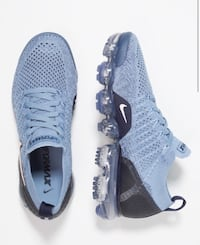 Pair of Womens Nike Vapormax Blue running shoes