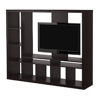 black flat screen TV with brown wooden TV hutch Alexandria, 22302