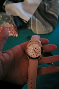 round gold-colored chronograph watch with brown leather strap St. Albert, T8N 2W8