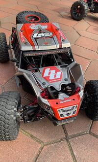Losi Rock Rey ( suped up with tons of metal parts)