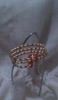 silver and red cuff bracelet