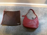 Red vintage hobo coach purse.