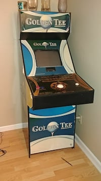 blue and gray Golden Tee arcade machine