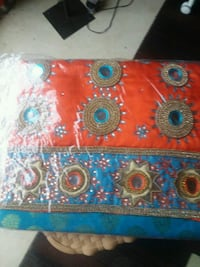 red, blue, and white floral textile London, N6M 0B5
