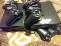 playstation 2 with 2 controllers and 11 games