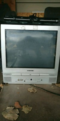 gray CRT TV with gray wooden TV stand