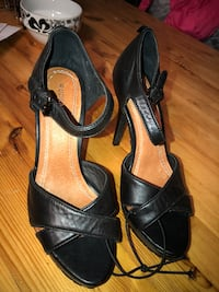 pair of black leather open-toe heeled sandals Saint-Eustache, J7R 5G3