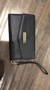 black leather Michael Kors wristlet 18 km