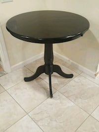 round brown wooden pedestal table East Providence, 02914