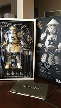White and black star wars action figure with box