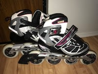 Pair of silver-and-black roller blades valeure 485$