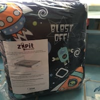 Black and orange Zipit Bedding textile in package Glendale