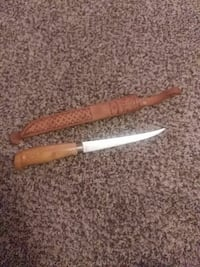 brown wooden handled combat knife with sheath