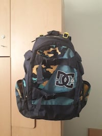 black and teal DC backpack
